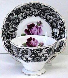 Black lace trimmed teacup with purple rose