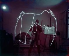 1949: Picasso paints in light