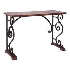 """Scrolling open metalwork console table with a distressed wood top and feet.  Product: Console tableConstruction Material: Iron and woodColor: Black and brown Features: Scrolling design Dimensions: 33"""" H x 43"""" W x 17"""" D"""