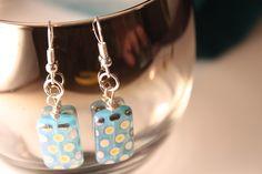 Earring, single flat rectangle bead. on silver.