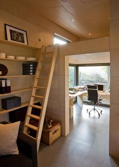 Great use of ceiling space. They split the office ceiling into a loft bedroom space - very efficient.  And great windows.