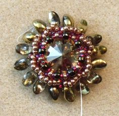 Make a Beaded Bezel In Just 5 Minutes! I know it would take me 30 minutes or longer, but I really want to learn how to do this! ~ Daily Beading Blogs