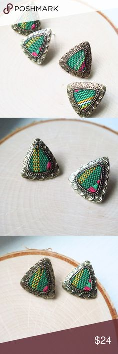"""Bohemian Stud Earrings Textile Canvas Aztec Prints Beautiful Bohemian Triangle Stud Earrings Featuring Bold Textile Canvas Fabric Centers!  This is our Bright Green, Pink & Yellow Blend Turkish Gold Burnish Tumble Distressed Finish """".75 x .75""""  Hypoallergenic, Lead/Nickel/Cadmium FREE! More Colors Available in our closet!  NWOT Boutique Packaged with Care  Tags. Gypsy, Coachella, Festival, Gypsy, bohemia, boho, pretty, studs, earring, big, large, statement, gift, vacation, cruise, getaway…"""