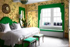 De Gournay's Sans Souci, a hand-painted silk wallcovering, turns a New York City master bedroom decorated by Miles Redd into a little paradise. The valances around the window and mirror add an exotic touch and are upholstered in the same fabric as the headboard and window-seat cushion, Extra Silk by Isaac Mizrahi for S. Harris. Bedding, Schweitzer Linen. Ceiling in Benjamin Moore's Blue Angel.   - HouseBeautiful.com