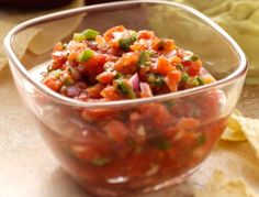 SALSA --------  Easiest Peasiest 2 minute Salsa ------ 1 can 14.5 oz Del Monte Petite Diced Tomatoes. Zesty Jalapeno. Drain juice. Drink juice. ............ Add to tomatoes some diced onion, diced Cubanel pepper, some crushed garlic, lime juice and a spoonful of Cilantro spice. ........ Place everything in a sealable plastic container. Shake it, baby, shake it. .......... Wala, done !!
