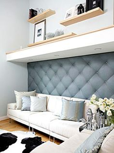 I could put an upholstered panel like this on the wall behind bunk beds to make them feel a bit more plush
