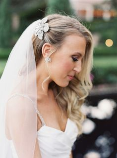 long curled wedding hair with one side clipped back - beautiful bridal hairpiece!  ~  we ❤ this! moncheribridals.com