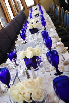 Our royal blue and white wedding bridal party blue wedding a simple but elegant blue and white color scheme blue centerpieceswedding junglespirit Image collections