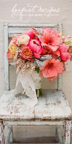 Pink, coral, orange yellow wedding bouquet with silver foliage and lace.  Lovely!
