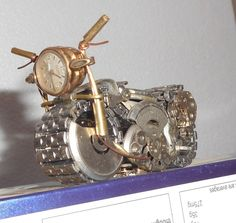 Collectible Steampunk watch parts motorcycle art piece home décor. My 106