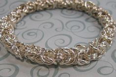 Free tutorial by photo Heavy Byzantine Bracelet Supplies - The project as shown uses (150) 16ga 4.5mm ID Jump rings.  But this project is very versatile and by changing the jump ring sizes, you can create many looks and textures.