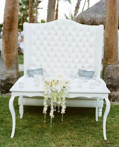 A sweetheart table is the main place at your wedding reception and it should excite and highlight your style and theme. Make an accent on your sweetheart table with a sequin tablecloth, lots of flowers and rhinestones.