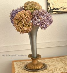 Vase made from light fixture and semi truck air horn.