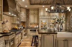 Gourmet luxury kitchen with stone pizza oven and large centre island. Nice cabinet colour & style.