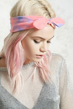 A headwrap featuring a colorful tie-dye wash and a wire bow accent.