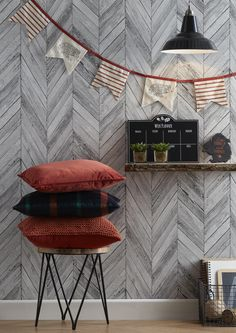 Rust coloured cushions, bunting and lots of textures can really create a snug and warm look during the colder months. Add a cup of tea and a fire and you're all set.