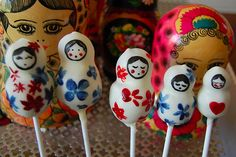 Russian Dolls  ~  Based out of London, Pop Cakes sweets are all the rage. And it's little wonder why. Fluffy chocolate sponge cake, fastened on a lolli stick, is dipped into cream cheese icing, then lovingly hand decorated by Pop Cakes' owner and founder, Clare O'Connell.