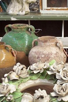 Old jugs from the old world and porcelain wreaths...
