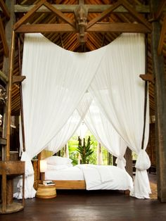 :: Bali inspired canopy bed.