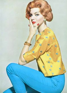 1959 Heather Hewitt in yellow India silk top scattered with turquoise peacocks worn with snug pants of turquoise-blue shantung by Tina Leser