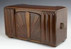 Rare Stygor Art Deco Radio, c. 1930, with two coils and two headsets, in a carved mahogany cabinet, H.- 9 1/2 in., W.- 16 1/2 in., D.- 7 1/4 in.