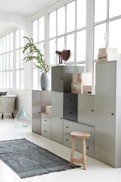 Asymmetrical Metal Cabinets, Window Wall, Vaulted Ceilings // office