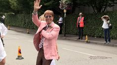 Cliff Richard looked to be in high spirits as he posed and chatted with fans in a pale pink jacket at Wimbledon 2013.