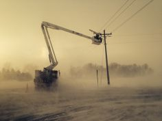 Linemen see a whole different world while taking care of  power lines. Lineman Lee took this surreal photo of the wind whipping snow around while Noah, his partner in restoring power, near Lexington. It was so cold, Lee's fingers, tough ungloved for only a few seconds, took a long time to thaw out!