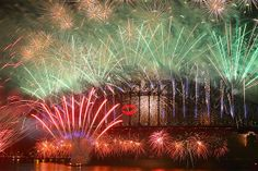 Midnight fireworks light up the sky from the Sydney Harbour Bridge in Sydney, Australia.... Image: New Year's celebrations (© Cameron Spencer/Getty Images)