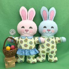 """Happy March 1! The Bunnies are gathering eggs to decorate for Easter which is one month from today. """"Easter Girl Bunny in Pajamas"""" and """"Easter Boy Bunny in Pajamas"""" are Cut and Sew fat quarter projects available in my Spoonflower shop. Have them printed on Kona Cotton to make wonderful soft toys. Link in Profile."""