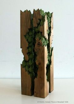 TANAKA Keisuke: While representation of figure has long been a central interest in wood sculpture, Keisuke Tanaka creates sceneries of forests and mountains in his sculpture. These sceneries are carved in wood pieces that were once a part of these sceneries.: