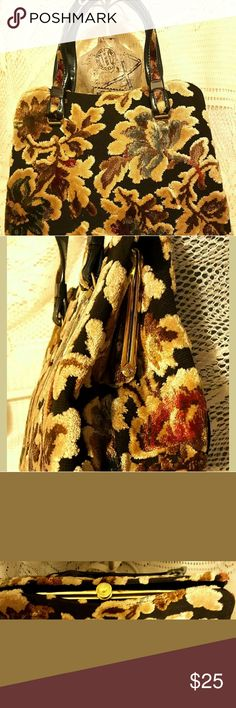 VtG GARAY Autumn Colors Tapestry Carpet Handbag This is an absolutely beautiful GARAY carpet tapestry Vintage handbag purse. The brown black yellow mustard rust green is such choice colors for this lovely purse. The interior is a black acetate or rayon feel material with a zipper pocket. The shiny gold snap lock clasp and hardware also shows the good condition of this handbag. Do get this for your collection.?  The measurements are as follows: approximately 8 inches in height, about 11…