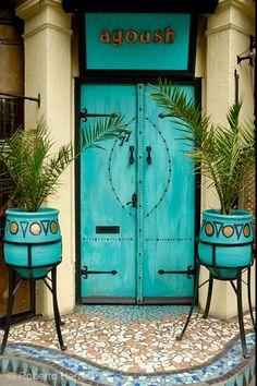 Turquoise door to Ayoush - North African members restaurant in London, England. - photo by Roberto Herrett