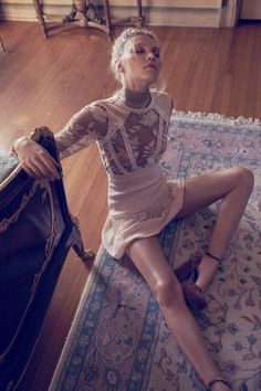 Model wears For Love & Lemons Emelia mini dress
