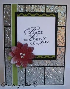 my faux tile poinsettia card  nice use of metal look.