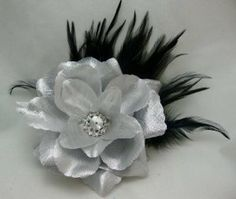 Silver Rose with Black Feathers Flower Hair Clip by hairflowers.net. $14.99. Feather. Rose. Hair Flowers. Color. Feather Hair Flowers. Silver Rose with Black Feathers Flower Hair Clip - 4.5 Inch Silver Rose Rhinestone Center Black Feathers Alligator Clip