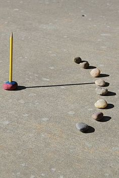 Do-It-Yourself Sundial~ This simple yet effective sundial was made by placing a pencil in a ball of clay. Every hour a stone was placed to mark time. The sundial in the picture goes from 9 a.m. to 4 p.m. Check out this fun blog post, and more at Otherwise Educating!