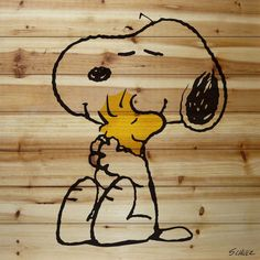 Description: The are best friends. Snoopy and Woodstock are hugging in this Peanuts art printed on natural pine wood. This iconic image of the friends would be perfect in a baby's nursery or in a chil