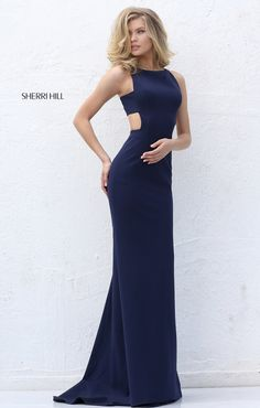 Creating a fitted silhouette, this Sherri Hill 50741 sleeveless dress showcases a bateau neckline and side cutouts on the midriff. The tapered back has a center zipper and the full-length skirt features an inset sweep train.