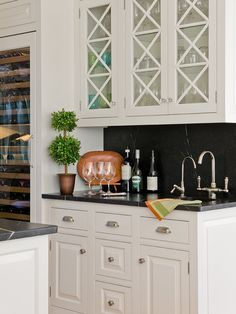 """Glass doors on upper cabinetry have an """"x"""" pattern."""