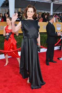 Sigourney Weaver donned a black ruffle-detailed satin gown with strappy gold sandals. #SAGAwards