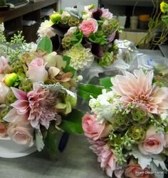 Bridal and bridesmaid bouquets with peachy/ pink dahlias, roses, scabiosa pods, baby eucalyptus, purple calla lilies and lemon leaf.