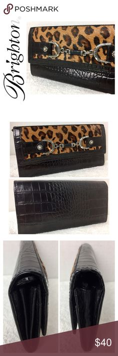 """Brighton Signature Leather Wallet Brighton Signature Leather Wallet in Basic Black Croc Embossed and Leopard print Faux Fur Exterior, Soft pebble stone Leather in Black and Signature Brighton Print Nylon for Interior, Snap Closure, 1 Clear ID Slot, 6 Card Slots, 1 Zippered Compartment for Coins, 2 Large Flat Compartments for Bills, 1 Large Expandable Slot, 1 Extra Large Slip Pocket, Approx. Size 3 3/4""""x 7 1/4"""", Normal Exterior Wear as shown in pics, Interior in Excellent Mint Condition…"""