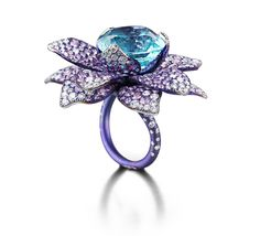 Suzanne Syz The Blue Lotus Ring in titanium, set with a 15.48ct Paraïba tourmaline, 326 pink sapphires totalling 11.01ct and 184 diamonds of 3.74ct.