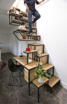 Clever stairs as shelving in small space.  Interior Design / Objet élevé by Studio Mieke Meijer