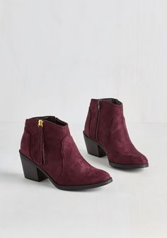 Lay of the Portland Bootie in Burgundy. A walk through Washington Park never looked so good when youre sporting these burgundy booties! #red #modcloth
