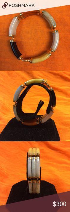 Triple bar 14K Gold Jade bracelet. Triple bar 14K Gold Jade bracelet. Yellow, black, white, orange and green jade. Great condition. Abstract link design. Jewelry Bracelets