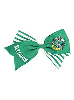 """<p>Large green & white cheer style bow from <i>Harry Potter</i> with a Slytherin themed design. Alligator clip & pinback options.</p>  <ul> <li>Approx. 7"""" across</li> <li>Imported</li> </ul>"""