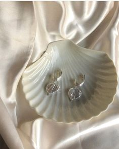 """Large modern pearl earrings """"The ancient Greeks associate pearls with Aphrodite, to symbolize her charm. They believed that the goddess of love was born out of the sea…"""" Goddess Of Love, Minimal Jewelry, Greeks, Aphrodite, Ancient Greek, Pearl Earrings, Charmed, Brooch, Sea"""