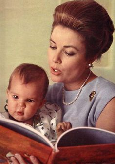 Princesse Grace of Monaco reads to her youngest daughter, Princess Stephanie